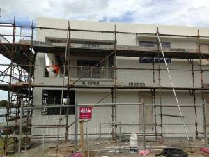 Multi-Level Residential Render Paint Project at Hope Island